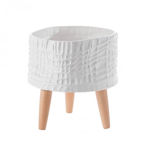 Macetero de cerámica con patas de madera