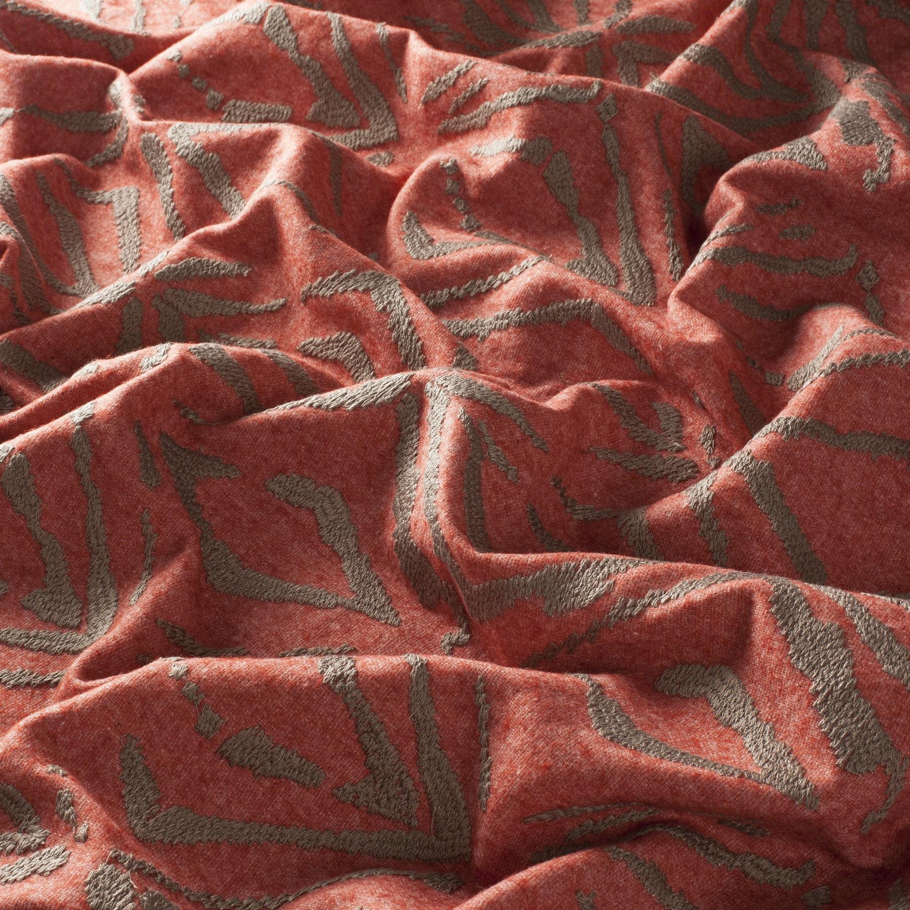 Tejido colo coral para tapizar el sofá